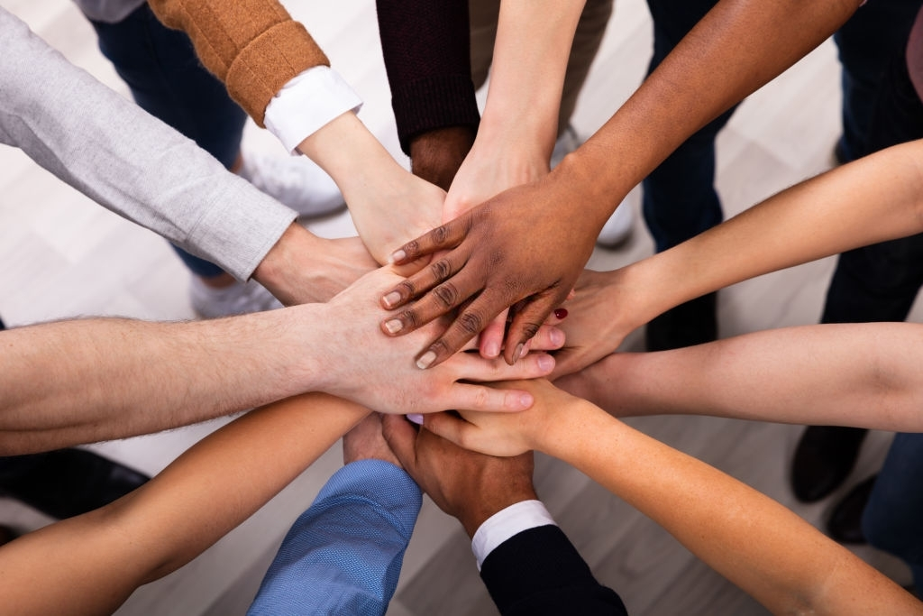 High Angle View Of Multiracial Friend Stacking Hand Together